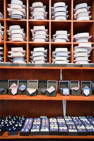 Shirts, neckties and hand cuff links displayed on shelves Stock Photo - Premium Royalty-Free, Code: 693-05794540