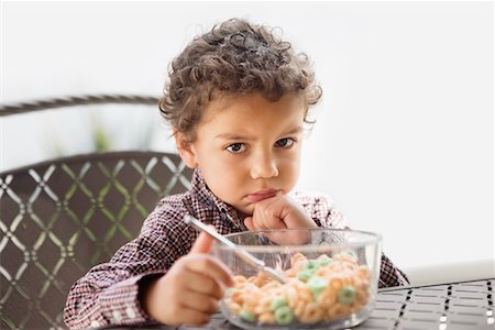 Grumpy child disappointed with his breakfast Stock Photo - Premium Royalty-Free, Code: 693-05793965