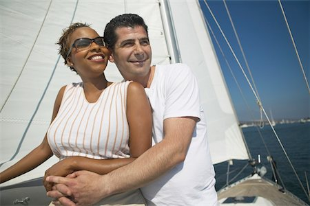 Affectionate Couple Relaxing on Yacht Stock Photo - Premium Royalty-Free, Code: 693-06014384