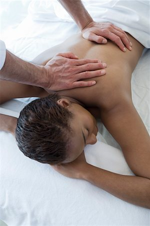 Woman having back massage Stock Photo - Premium Royalty-Free, Code: 693-06016508