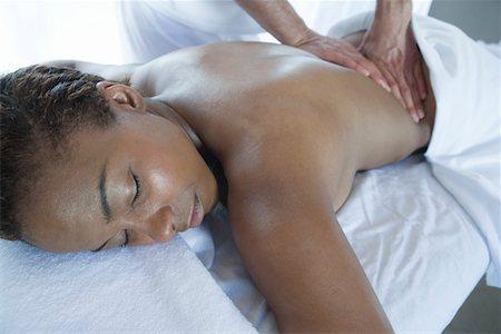 Woman having back massage Stock Photo - Premium Royalty-Free, Code: 693-06016511