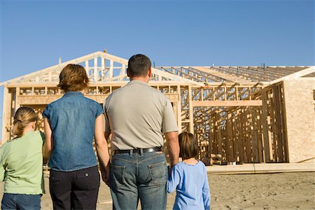 Family with two children (6-9) at construction site, back view Stock Photo - Premium Royalty-Free, Code: 693-06017471