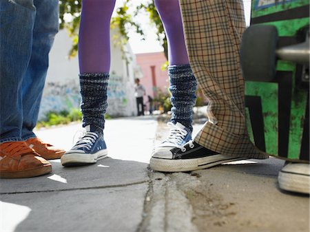 Teenage Friends on Sidewalk Stock Photo - Premium Royalty-Free, Code: 693-06018429