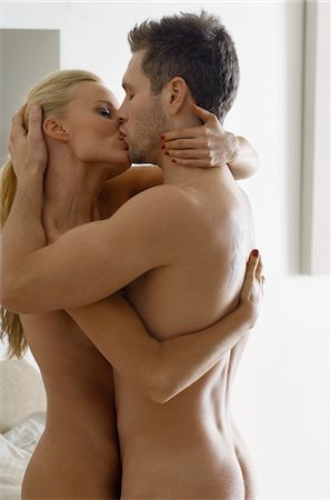 Naked Young Couple Kissing Stock Photo - Premium Royalty-Free, Code: 693-06019229