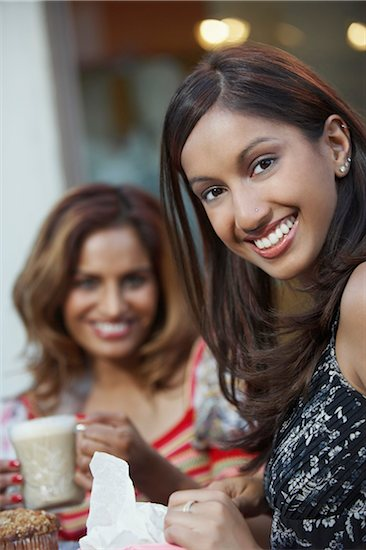 Portrait of two women at cafe table Stock Photo - Premium Royalty-Free, Image code: 693-06019319