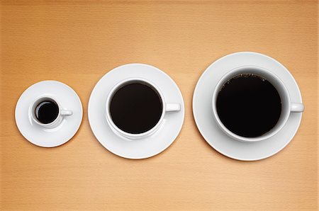 Three coffee cups of various sizes Stock Photo - Premium Royalty-Free, Code: 693-06020280