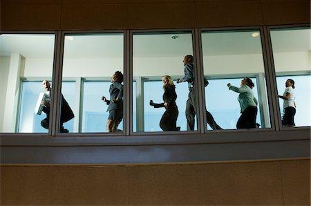running away scared - Businesspeople Running down Hallway Stock Photo - Premium Royalty-Free, Code: 693-06020402