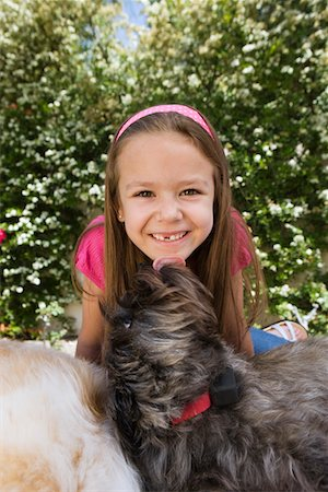 preteen girl licking - Dog Licking Little Girl's Chin Stock Photo - Premium Royalty-Free, Code: 693-06020636