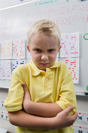 Angry Little Boy in a Classroom Stock Photo - Premium Royalty-Free, Code: 693-06020661