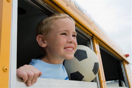 Boy on School Bus Stock Photo - Premium Royalty-Free, Image code: 693-06020808
