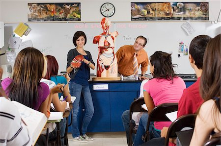 Student Giving Presentation in Science Class Stock Photo - Premium Royalty-Free, Code: 693-06021054