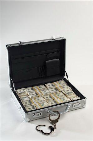 seamless - Briefcase Full of Money Stock Photo - Premium Royalty-Free, Code: 693-06021287