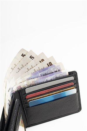 seamless - Wallet Full of Money Stock Photo - Premium Royalty-Free, Code: 693-06021335