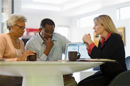 Financial Advisor Assisting Senior Couple Stock Photo - Premium Royalty-Free, Code: 693-06021705