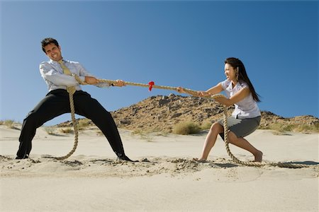 Two Business People Playing Tug of war in the Desert Stock Photo - Premium Royalty-Free, Code: 693-06021784