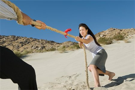 Two Business People Playing Tug of war in the Desert Stock Photo - Premium Royalty-Free, Code: 693-06021785