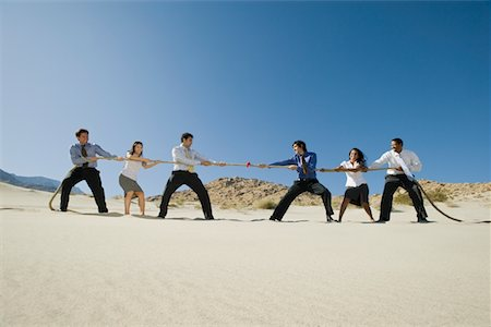 Business People Playing Tug of war in the Desert Stock Photo - Premium Royalty-Free, Code: 693-06021782