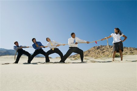 Business People Playing Tug of war in the Desert Stock Photo - Premium Royalty-Free, Code: 693-06021783
