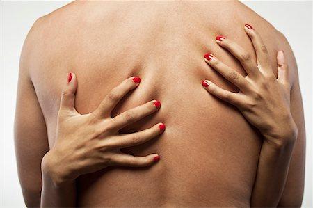 Woman's hands embracing man's torso Stock Photo - Premium Royalty-Free, Code: 693-06021791