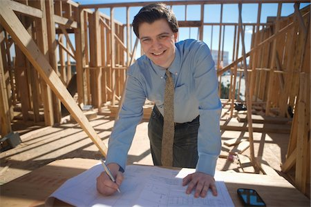 Site manager with building plans Stock Photo - Premium Royalty-Free, Code: 693-06022181