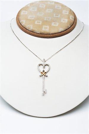 expensive jewelry - 18k white gold key pendant with 0.50 carat diamonds Stock Photo - Premium Royalty-Free, Code: 693-06022197