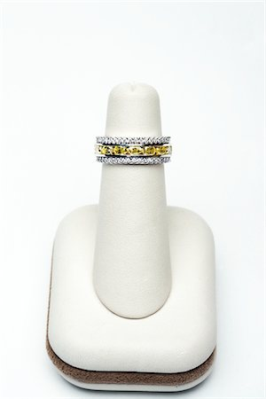 expensive jewelry - 3 platinum stackable rings with 2.75 carat yellow oval diamonds and 1.00 carat full cut diamonds Stock Photo - Premium Royalty-Free, Code: 693-06022198
