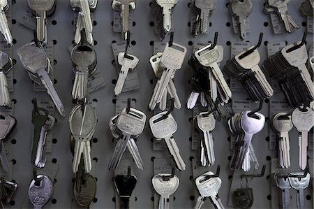 Keys hanging on hooks in store Stock Photo - Premium Royalty-Free, Code: 693-06120834