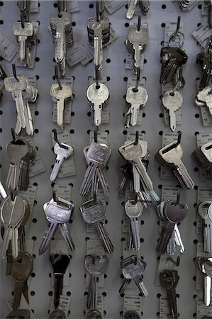 Large group of keys hanging on hooks in store Stock Photo - Premium Royalty-Free, Code: 693-06120833