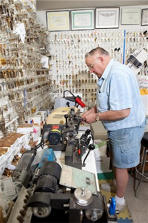 Side view of senior locksmith working in store Stock Photo - Premium Royalty-Free, Code: 693-06120840