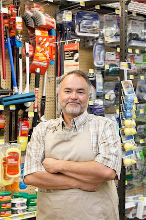 showing - Portrait of a confident mature store clerk with arms crossed in hardware shop Stock Photo - Premium Royalty-Free, Code: 693-06121045
