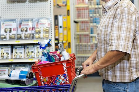 Midsection of man with shopping cart in hardware store Stock Photo - Premium Royalty-Free, Code: 693-06121058