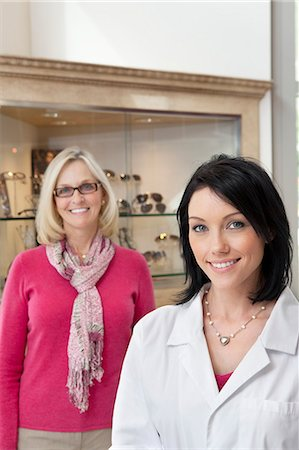 pretty - Portrait of happy mid adult optician and customer wearing glasses Stock Photo - Premium Royalty-Free, Code: 693-06121103