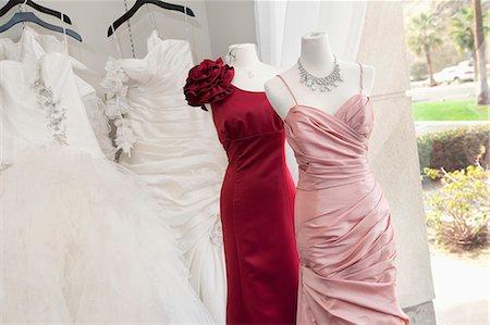 Wedding dress on display in bridal store Stock Photo - Premium Royalty-Free, Code: 693-06121237