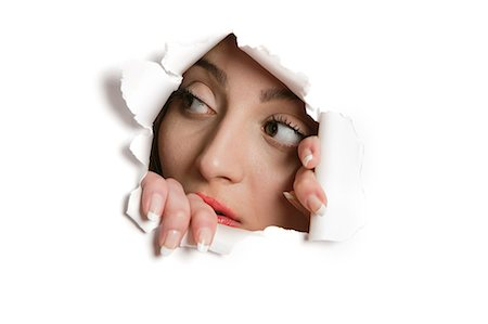 paper - Young Middle eastern woman looking away from ripped paper hole Stock Photo - Premium Royalty-Free, Code: 693-06121329