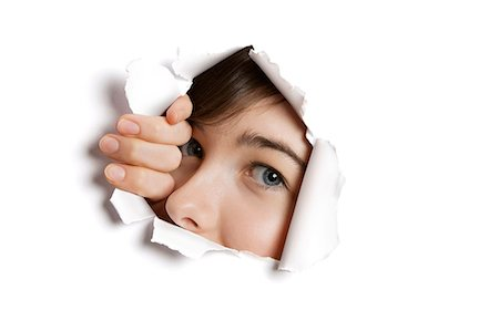 paper - Portrait of a young Middle eastern woman peeking from ripped white paper hole Stock Photo - Premium Royalty-Free, Code: 693-06121333