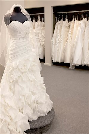 Elegant wedding dress displayed on mannequin in bridal store Stock Photo - Premium Royalty-Free, Code: 693-06324080