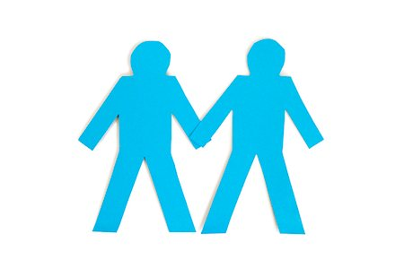 Two blue paper stick figures holding hands over white background Stock Photo - Premium Royalty-Free, Code: 693-06324339