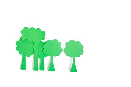 Paper cut outs of green trees over white background Stock Photo - Premium Royalty-Free, Code: 693-06324349
