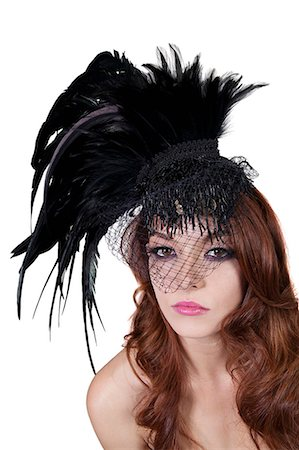 feather  close-up - Portrait of young brunette wearing feathered veil over white background Stock Photo - Premium Royalty-Free, Code: 693-06324535
