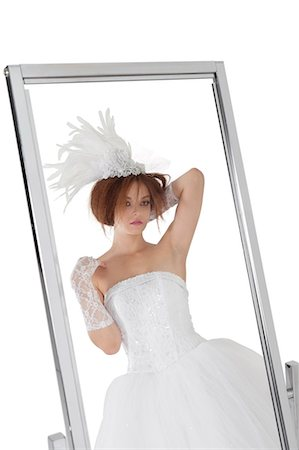 Reflection of young bride in mirror over white background Stock Photo - Premium Royalty-Free, Code: 693-06324554