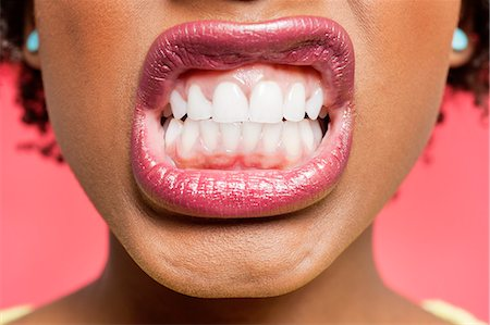 Cropped image of woman clenching teeth Stock Photo - Premium Royalty-Free, Code: 693-06324641