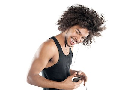 Portrait of a happy young man with mp3 player over white background Foto de stock - Sin royalties Premium, Código: 693-06324718