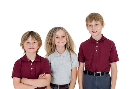 Portrait of happy school children in uniform over white background Stock Photo - Premium Royalty-Free, Code: 693-06324786
