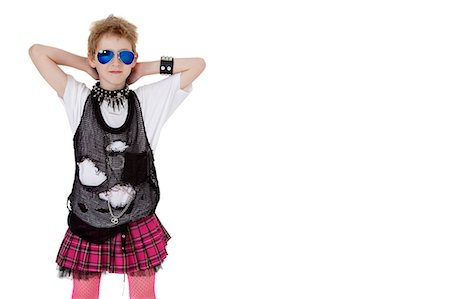 pantyhose kid - Portrait of punk kid in fancy dress with hands behind head over white background Stock Photo - Premium Royalty-Free, Code: 693-06324844