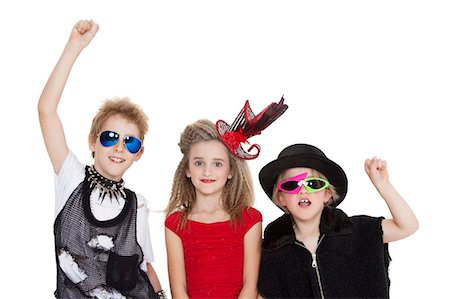 pantyhose kid - Portrait of kids fancy dress outfit with raised fist over white background Stock Photo - Premium Royalty-Free, Code: 693-06324841