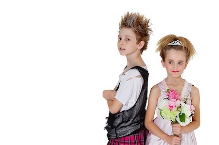 Portrait of punk boy with bridesmaid holding flower bouquet over white background Stock Photo - Premium Royalty-Free, Code: 693-06324851