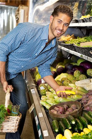 Portrait of a happy man shopping for vegetables in market Stock Photo - Premium Royalty-Free, Code: 693-06324923