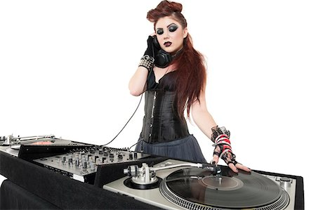 Beautiful punk DJ over white background Stock Photo - Premium Royalty-Free, Code: 693-06324974