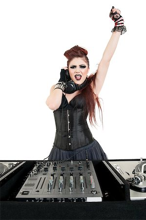 Portrait of punk DJ with arm raised over white background Stock Photo - Premium Royalty-Free, Code: 693-06324976