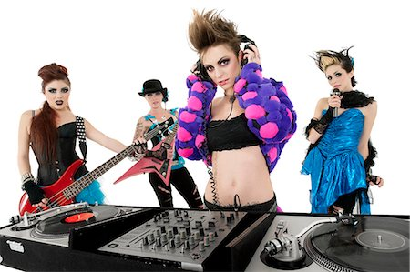 Portrait of all female punk rock band over white background Stock Photo - Premium Royalty-Free, Code: 693-06324980